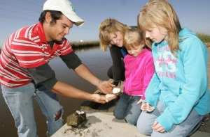 happy family outdoor observes shucked oyster